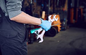 Right to Repair Mechanic with Wrenches